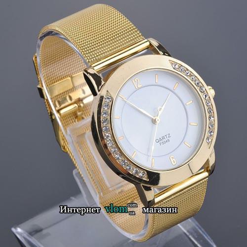 Женские золотые часы со стразами